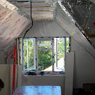 <p>Foil backed insulation being fitted.</p>