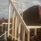 <p>The first dormer roof timbers start to be erected.</p>