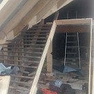 <p>The new roof is built over the top of the existing one.</p>