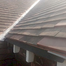 <p>Open rafter detail as existing . Good tiles re-used on front elevation so the new roof blends in as much as possible.</p>
